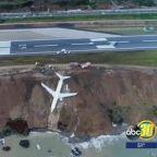 Passenger plane left stuck on cliff edge after skidding off runway in Turkey