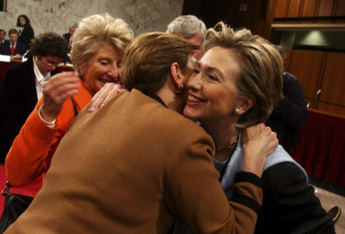 Senator Hillary Clinton hugs Jamie Gorelick, a commission member, during the second public hearing of the 9/11 Commission