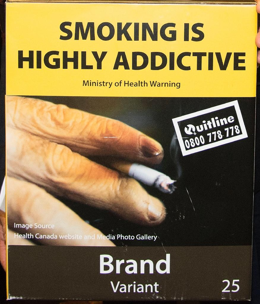 New Zealand will introduce plain packaging on tobacco products, selling them in drab boxes plastered with health warnings and gruesome pictures of smoking-related disease (AFP Photo/Marty Melville)