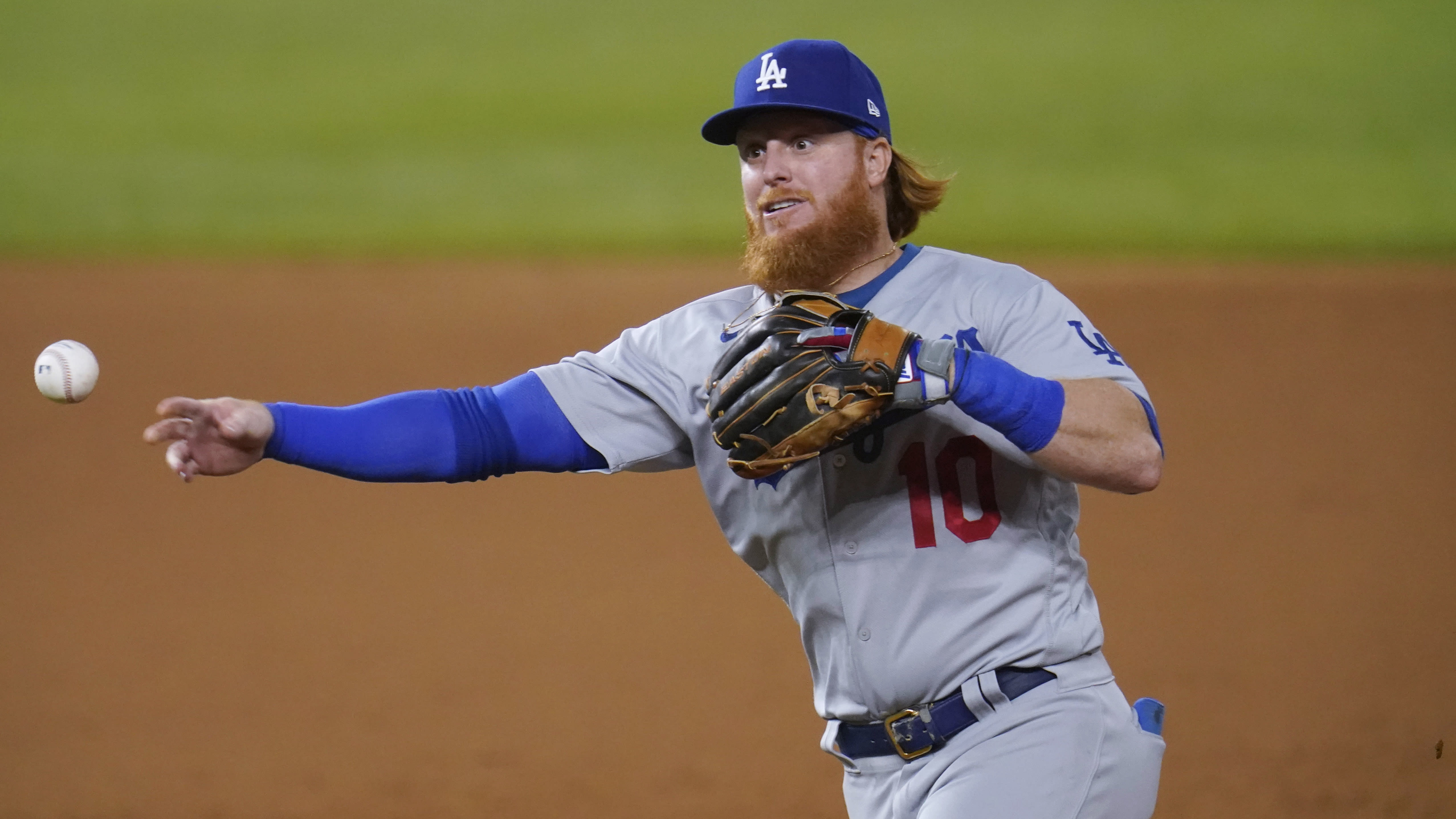 Los Angeles Dodgers' Justin Turner fields a ground out by San Diego Padres Eric Hosmer during the eighth inning in Game 3 of a baseball National League Division Series Thursday, Oct. 8, 2020, in Arlington, Texas. (AP Photo/Sue Ogrocki)