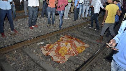 Train slams into festival crowd in India, kills dozens