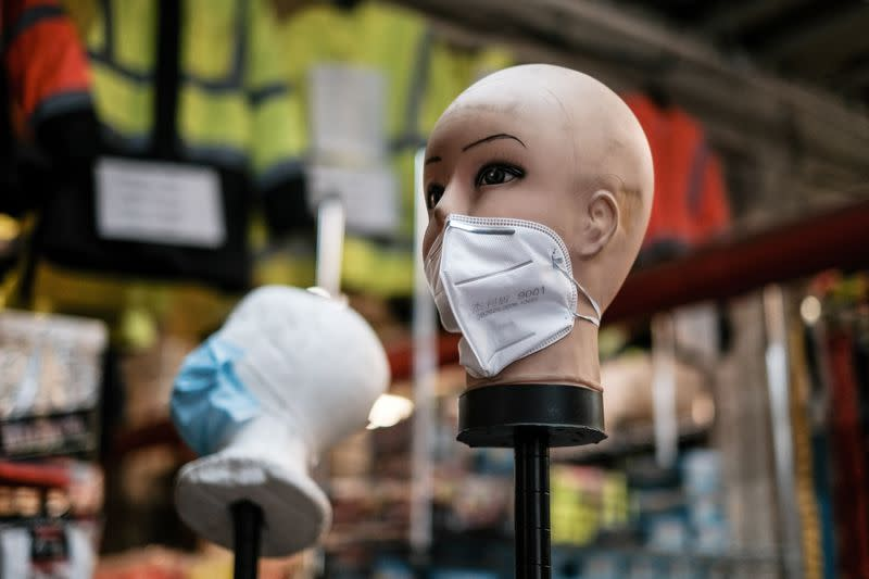 FILE PHOTO: A mannequin displays disposable face masks at a safety equipment store in the Brooklyn borough of New York City, U.S.