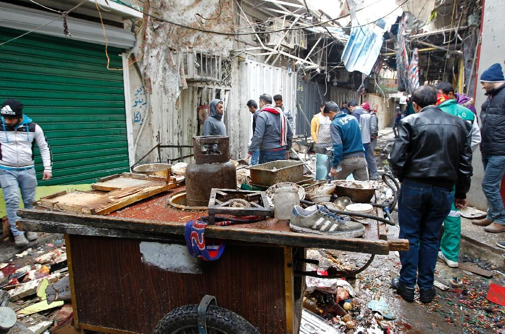 Two suicide bombers attacked Baghdad's central Al-Sinek neighbourhood killing at least 27 people and wounding 53, a police colonel said (AFP Photo/SABAH ARAR)