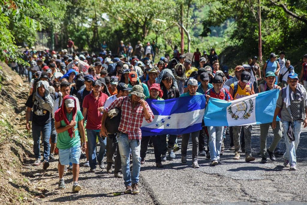 "Honduran migrants take part in a new caravan heading to the US: Trump administration officials say the surge in illegal immigration has become a ""crisis"" for the country"