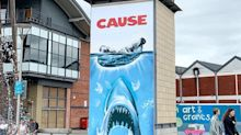 Street Artist Reworks Iconic 'Jaws' Poster In Swipe At Plastic Pollution