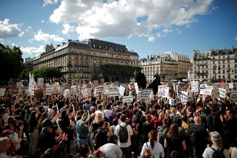 Feminist activists demonstrate against new government appointments in Paris