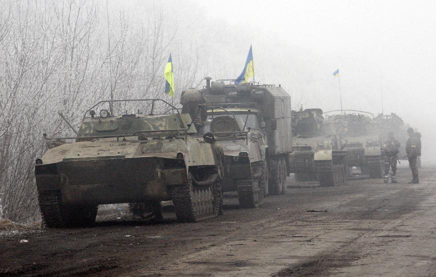 Ukrainian vehicles are parked on a road between Artemivsk and Debaltseve, Donetsk region, on February 15, 2015