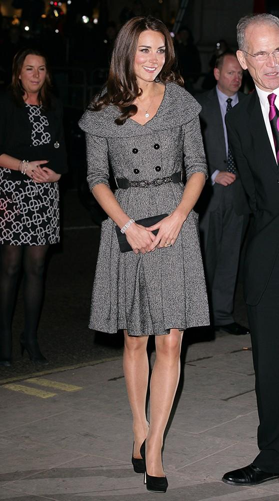 Kate visited the National Portrait Gallery in a belted grey jacket with a wide collar.