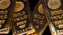 Gold pushes higher as dollar sinks to 8-month lows