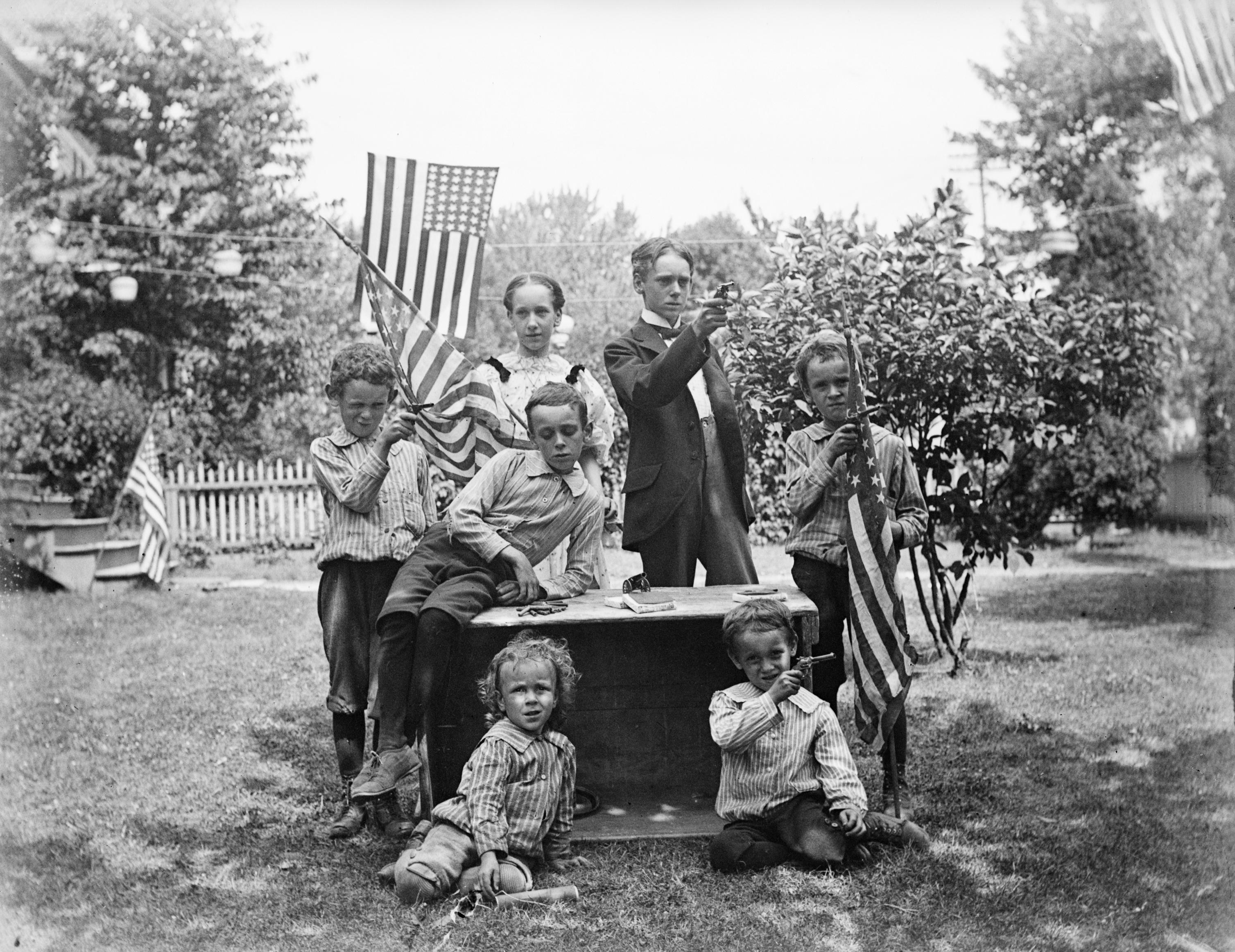 <p>Family with pistols and flags get ready for their Fourth of July celebration, circa 1880s (Photo: Bettmann Archive/Getty Images) </p>