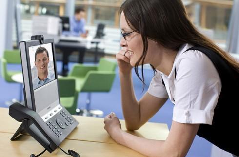Tandberg E20 desktop videoconferencing phone says 'Me too!'