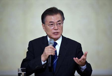 FILE PHOTO - South Korean President Moon Jae-In speaks during a press conference marking his first 100 days in office at the presidential house in Seoul
