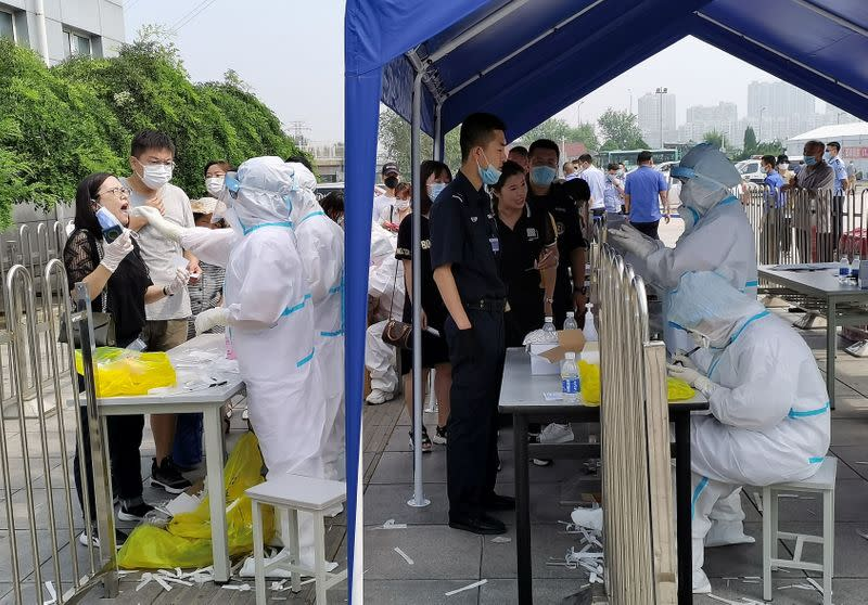 Covid-19 outbreak in Xinjiang prompts fears of spread inside China's camps