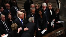 George W. Bush hands Michelle Obama a treat at his father's funeral, and the internet loves it