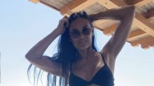 Demi Moore, 58, enjoys 'another day in paradise' with bikini photo