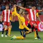 Atletico defy Griezmann red card to salvage Girona draw