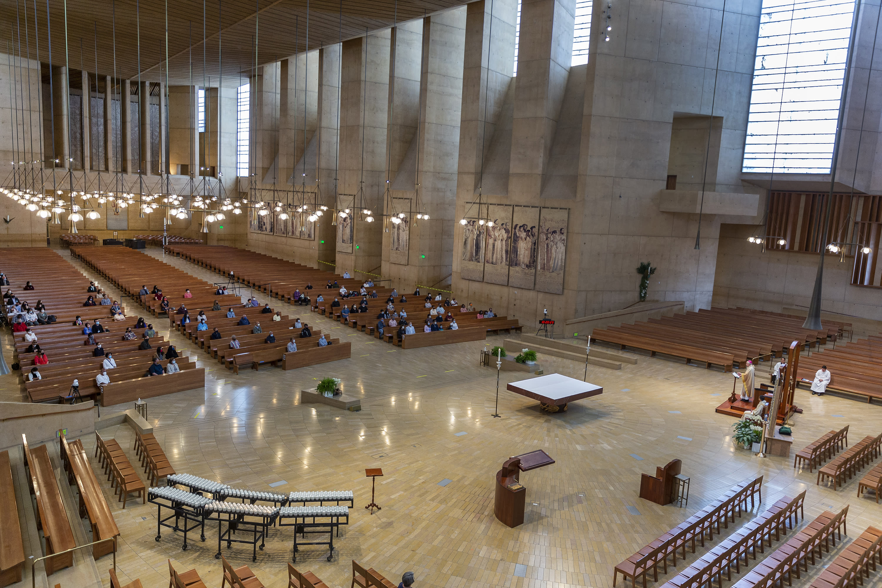 FILE - Los Angeles Archbishop Jose H. Gomez celebrates the first English Mass with the faithful present, at the nation's largest Catholic Archdiocese in Los Angeles, Sunday, June 7, 2020. A religious freedom law firm with ties to President Donald Trump says it will sue California over its recent ban on singing or chanting in the church to slow the spread of the coronavirus. (AP Photo/Damian Dovarganes, File)