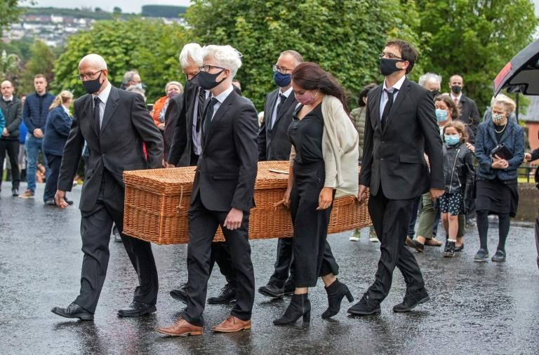 The wicker casket containing Hume's remains was brought into St Eugene's Cathedral in Londonderry on Tuesday evening (AFP Photo/Paul Faith)