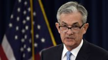 The Latest: Powell says politics not part of policy decision