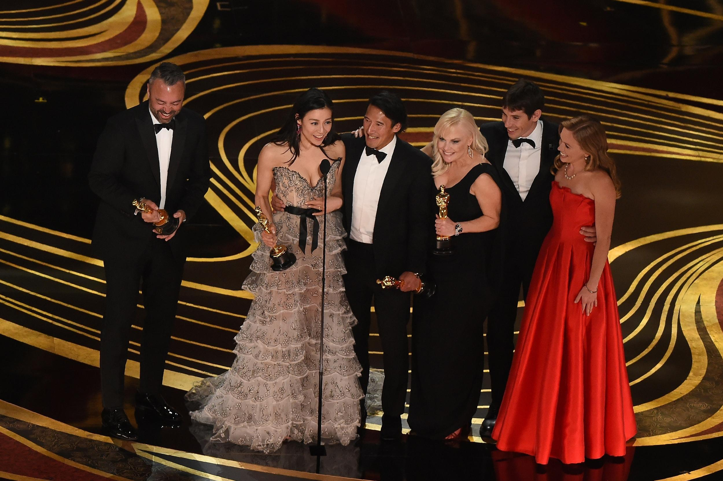 The crew of 'Free Solo' accepts the Oscar for Best Documentary during the 91st Annual Academy Awards at the Dolby Theatre in Hollywood, California on February 24, 2019. (Photo by VALERIE MACON / AFP)        (Photo credit should read VALERIE MACON/AFP/Getty Images)