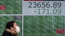 Asian markets slip amid warnings that China virus remains a threat