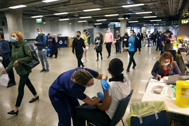 Pandemic not over, Johnson warns as England set for rule easing