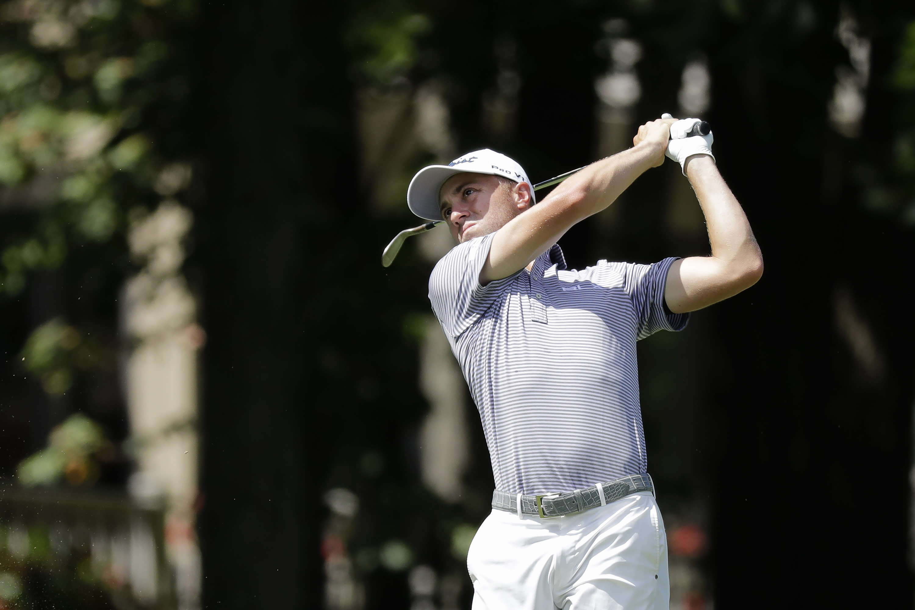 Justin Thomas hits toward the ninth green during the second round of the Memorial golf tournament, Friday, July 17, 2020, in Dublin, Ohio. (AP Photo/Darron Cummings)