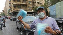Lebanon set for new virus lockdown, Biden vows action from 'day one'