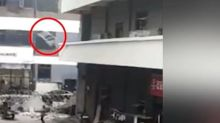 Chinese woman miraculously survives after being hit by iron bed frame thrown out of building