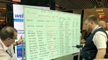 Gatwick, UK's no.2 airport, shows flights on white boards after IT fails