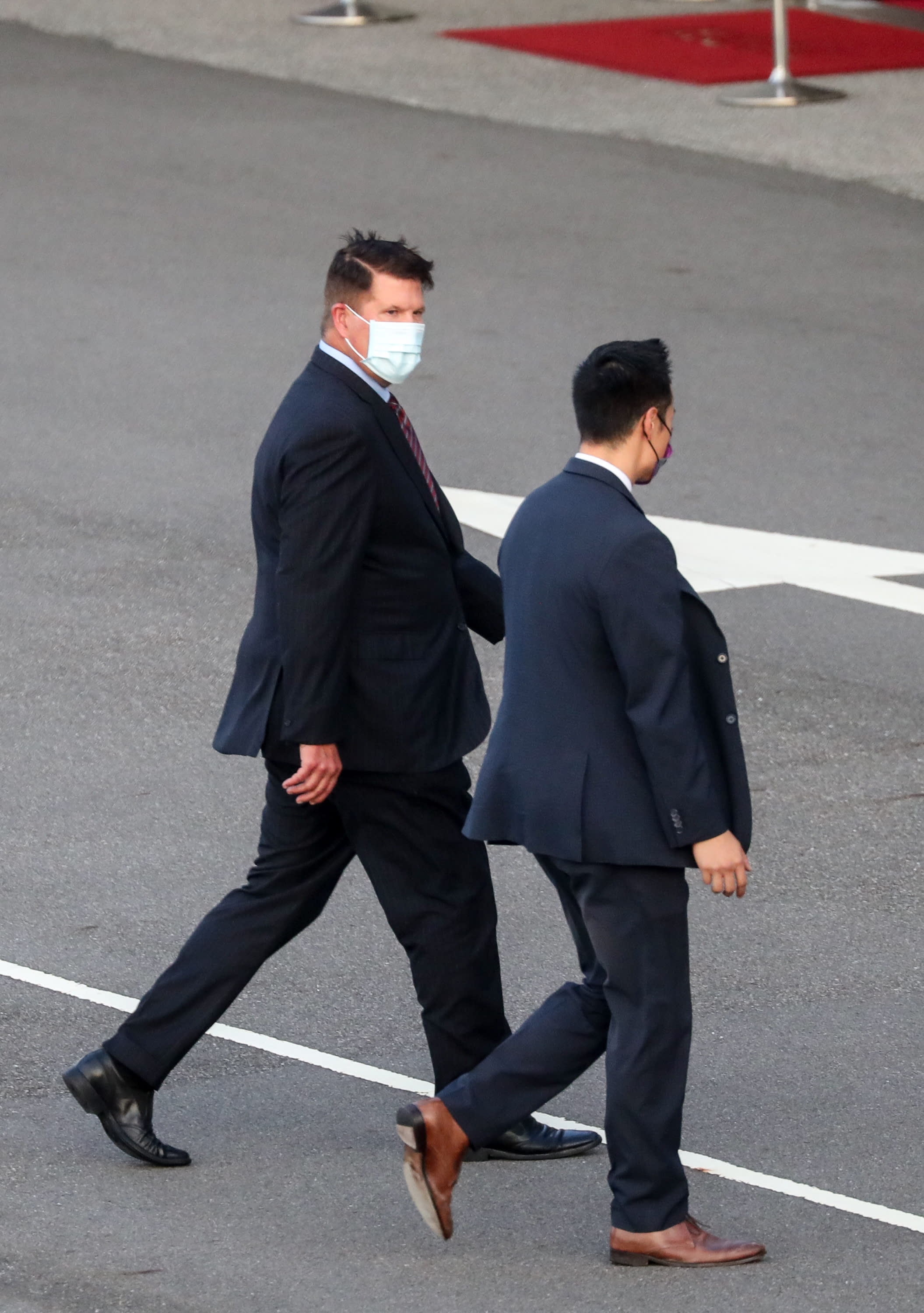 FILE - In this file photo taken Thursday, Sept. 17, 2020, U.S. Undersecretary of State Keith Krach, walks away after disembarking from a plane upon arrival at an airforce base in Taipei. Taiwan. The second U.S. high level envoy to visit Taiwan in two months began a day of closed-door meetings Friday, as China conducted military drills near the Taiwan Strait after threatening retaliation. (Pool Photo via AP Photo, File)