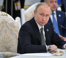 Putin promises brighter future as marathon phone-in takes gloomy turn