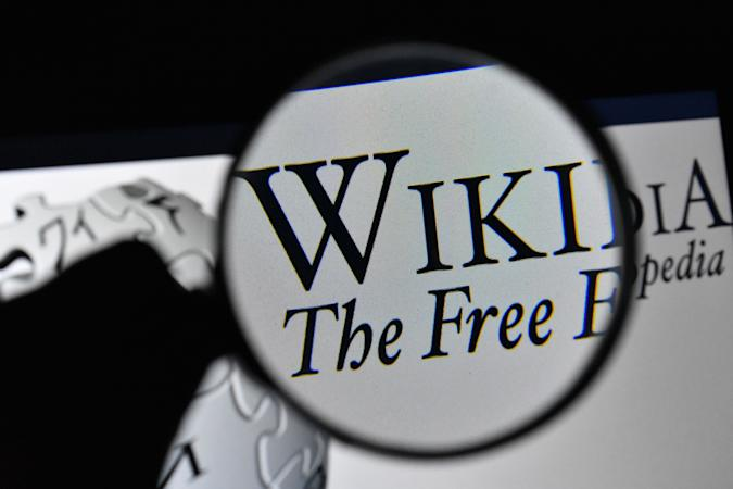 ANKARA, TURKEY - JANUARY 15: (BILD ZEITUNG OUT) In this photo illustration, The logo of Wikipedia is seen on the screen of a laptop with a magnifying glass on January 15, 2021 in Ankara, Turkey. (Photo by Altan Gocher/DeFodi Images via Getty Images)
