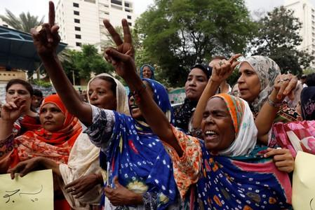 Supporters of political party Pakistan People's Party (PPP) chant slogans during a protest in Karachi