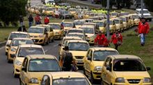 Thousands of Bogota taxi drivers protest Uber, Cabify and higher costs