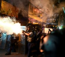 China says it won't 'sit by' on Hong Kong, Trump expresses concern