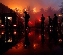Fire destroys landmark hotel in Myanmar's largest city, kills one