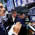 US STOCKS-Wall St inches lower as trade concerns linger