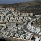 Israelis celebrate, Palestinians rail against US settlement move