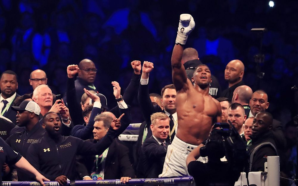 Anthony Joshua acknowledges the packed stands at Wembley Stadium following what will go down as one of the great fights in modern day boxing - PA