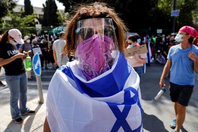 Israeli demonstrators, angry at the new government powers to restrict gatherings, protest outside parliament ahead of the vote