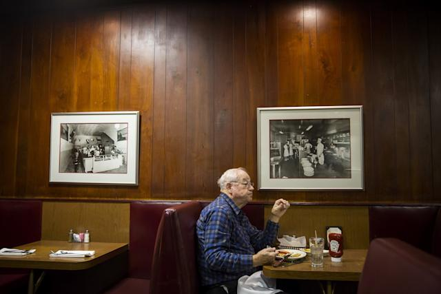 Bob Moore, a retiree who supported Donald Trump, eats at Cattlemen's Steakhouse Dec. 1 in Oklahoma City, Okla. (Photo: Eric Thayer for Yahoo News)