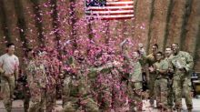 US soldiers in Afghanistan shoot pink confetti to reveal sex of fallen comrade's baby