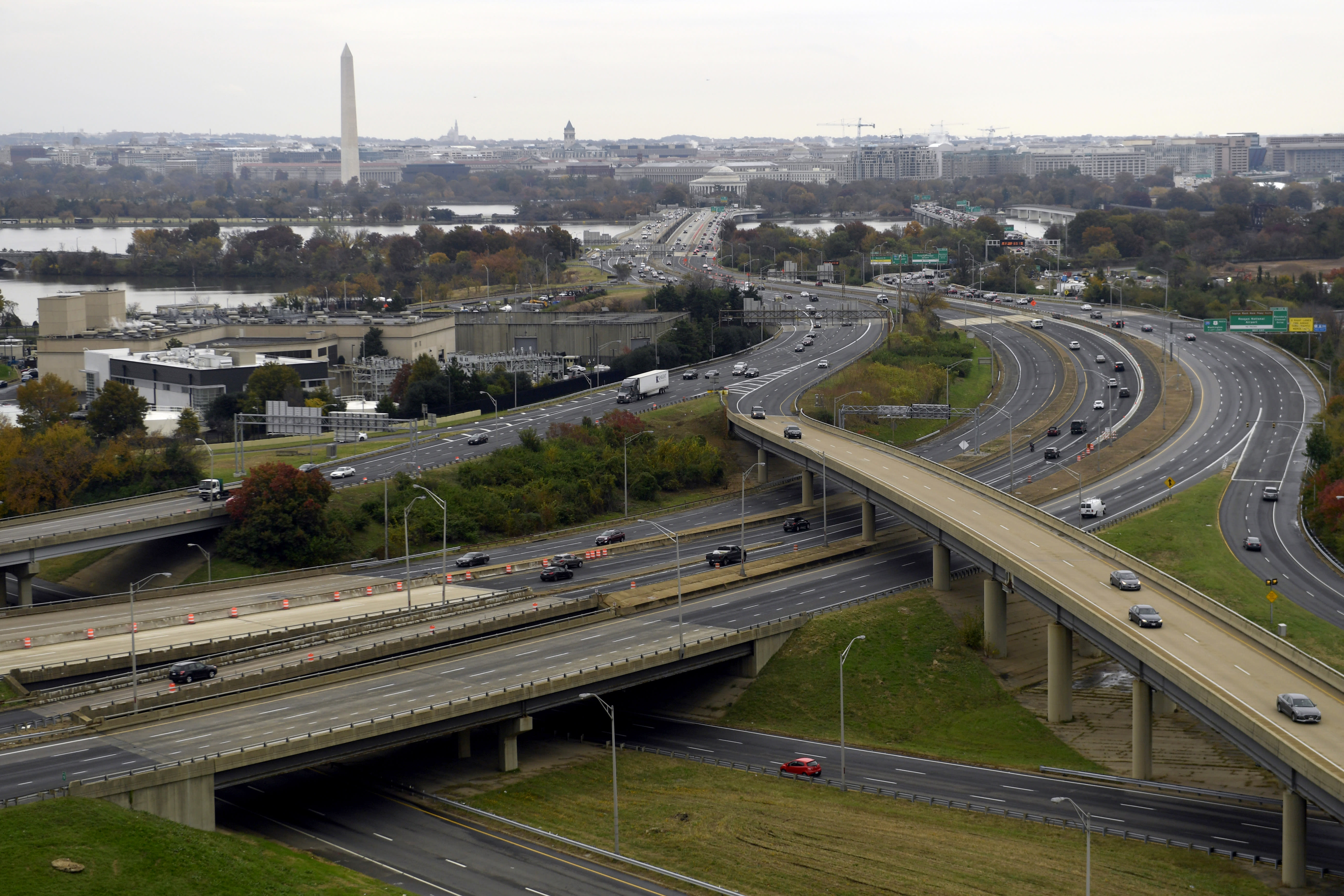 "FILE- This Friday, Nov. 9, 2018, file photo, shows a view of Washington from a revolving restaurant in Crystal City, Va. On Tuesday, Nov. 13, Amazon said it will split its second headquarters between Long Island City in New York and Crystal City. Development along major highways in Northern Virginia and Washington have led to ""unreasonable traffic delays on a daily basis"" in the past few years, with drive times that used to take 40 minutes ballooning to up to 90 minutes, said Thomas Cooke, professor of business law at Georgetown University's McDonough School of Business. (AP Photo/Susan Walsh, File)"