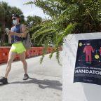 Florida's new coronavirus cases break record, nearly tying New York's peak