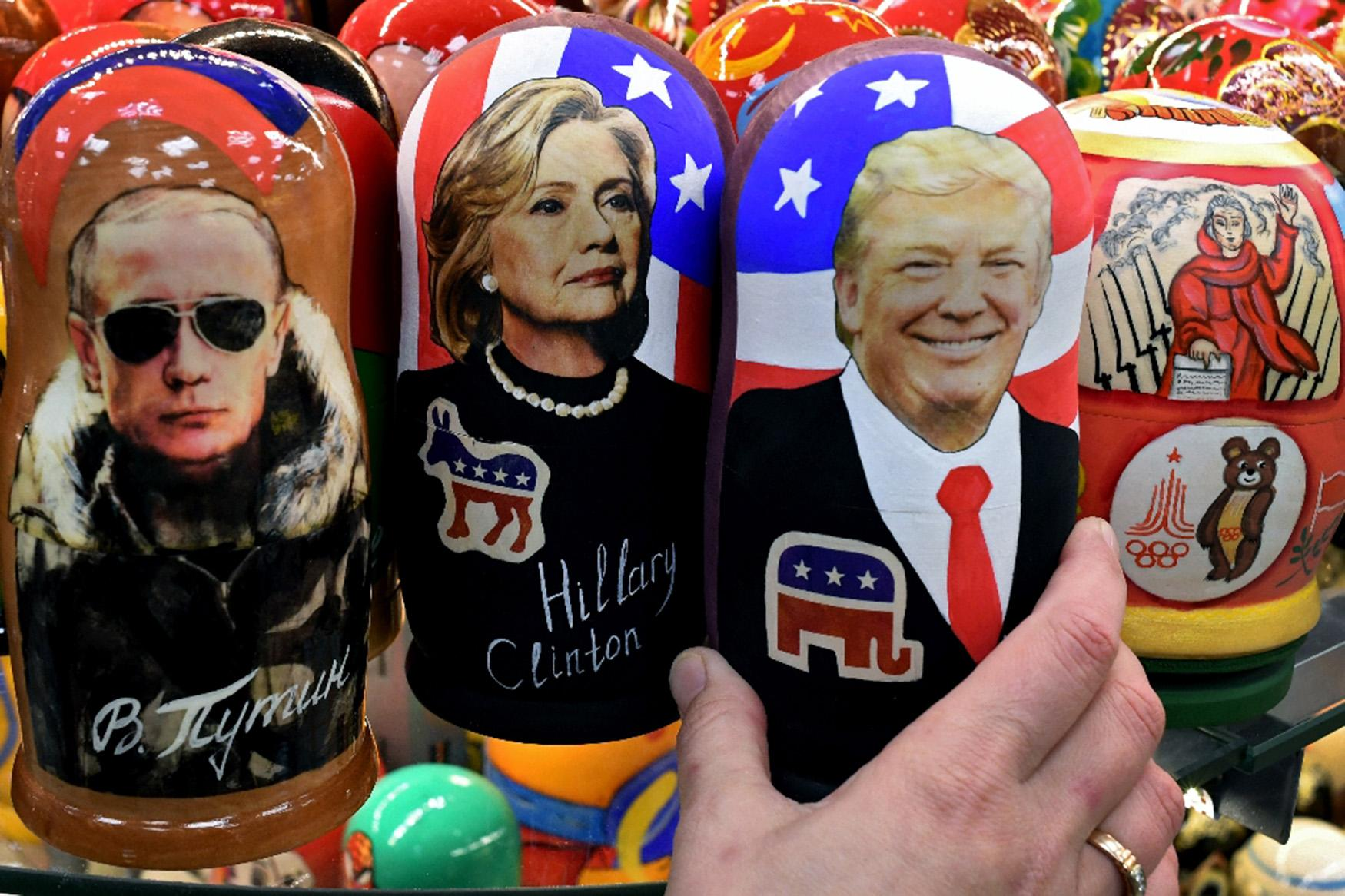 <p>Traditional Russian Matryoshka dolls in Moscow, depict (left to right) Russian President Vladimir Putin, Hillary Clinton and U.S. President- elect Donald Trump. (Kirill Kudryavtsev/AFP Photo) </p>