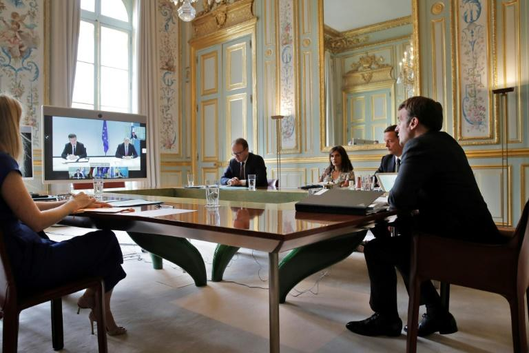 French President Emmanuel Macron, right, at the Elysee Palace in Paris on Friday during the video conference with leaders of Serbia and Kosovo. (AFP Photo/Christophe Ena)
