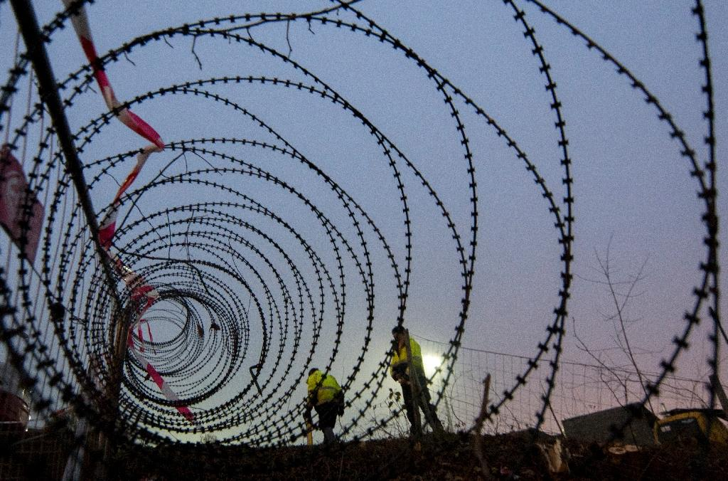 A barbed wire fence is erected at a border crossing between Austria and Slovenia at Spielfeld, Austria in December 2015 (AFP Photo/Joe Klamar)