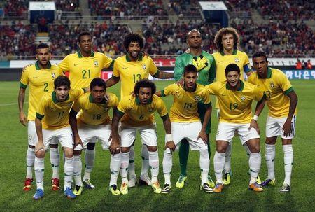 Brazil's national soccer team players pose for a team photo before a friendly soccer match against South Korea at the Seoul World Cup stadium