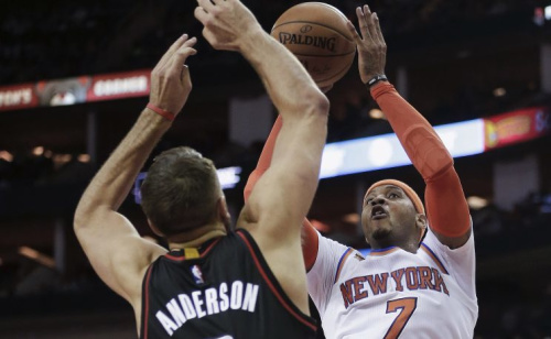 Carmelo Anthony probably wouldn't mind trading places with Ryan Anderson. (AP)